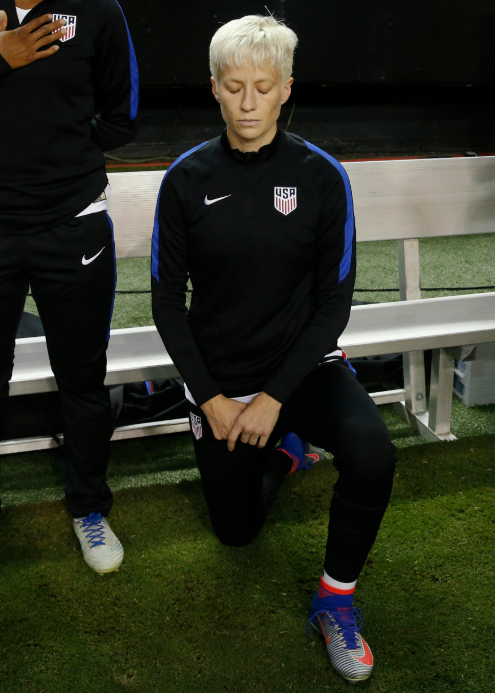 Megan Rapinoe Takes a Knee in Protest Just Like Cop Blaster